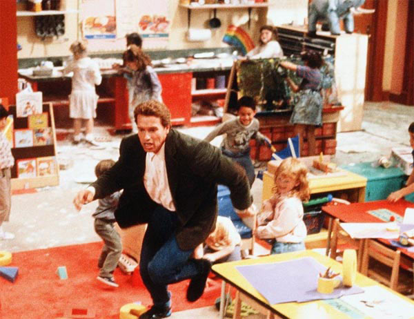 Arnold Schwarzenegger appears in a scene from the 1990 film 'Kindergarten Cop.'