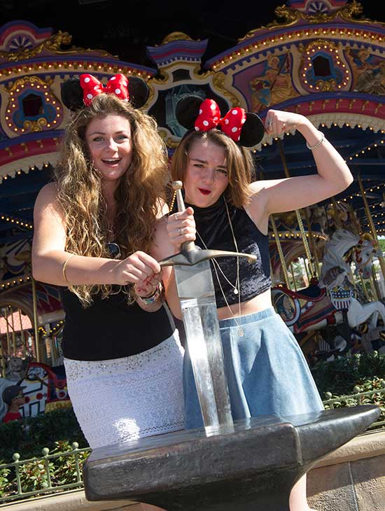 Maisie Williams &#40;right&#41;, who plays Arya Stark on the HBO series &#39;Game of Thrones,&#39; poses with her friend Cassidy Waterhouse &#40;left&#41;, after pulling the sword from the stone at the Magic Kingdom Park at the Walt Disney World Resort in Lake Buena Vista, Florida on Aug. 29, 2013. <span class=meta>(Gene Duncan &#47; Walt Disney World)</span>