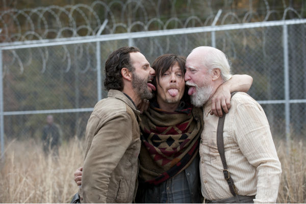 "<div class=""meta ""><span class=""caption-text "">Andrew Lincoln (Rick Grimes), Norman Reedus (Daryl Dixon) and Scott Wilson (Hershel Greene) appear on the prison set of AMC's 'The Walking Dead' season 4 finale, which aired on March 30, 2014. (Gene Page / AMC)</span></div>"