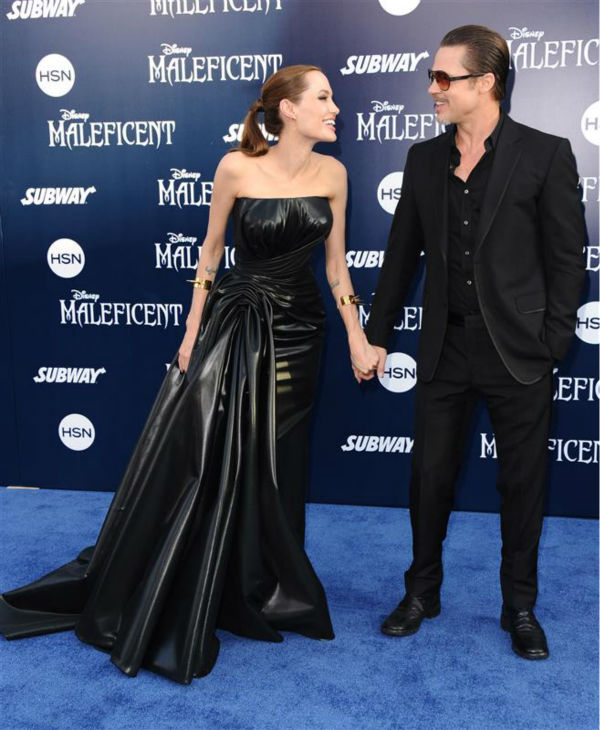 Angelina Jolie and Brad Pitt attend the premiere of Disney&#39;s &#39;Maleficent&#39; in Hollywood, California on May 28, 2014. <span class=meta>(Sara De Boer &#47; Startraksphoto.com)</span>
