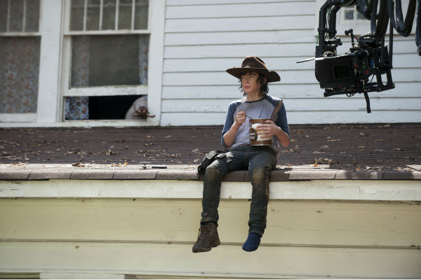 Chandler Riggs &#40;Carl Grimes&#41; eats a 112-oz &#40;7-lb&#41; can of chocolate pudding while sitting on a roof on the set of AMC&#39;s &#39;The Walking Dead&#39;s season 4 midseason premiere, which aired on Feb. 9, 2014. <span class=meta>(Gene Page &#47; AMC)</span>