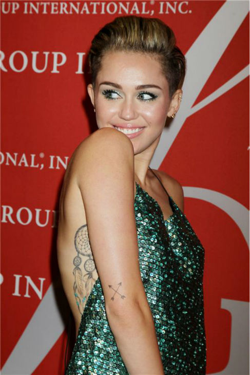 Miley Cyrus arrives at the 30th annual Night of Stars gala in New York on Oct. 22, 2013.
