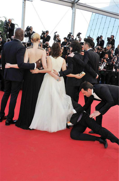 "<div class=""meta image-caption""><div class=""origin-logo origin-image ""><span></span></div><span class=""caption-text"">A security official tries to restrain notorious prankster of celebrities, Ukrainian reporter Vitalii Sediuk, after he crawled under actress America Ferrera's ball gown at a screening of 'How To Train Your Dragon 2' at the 2014 Cannes Film Festival on Friday, May 16, 2014. Also pictured: Kit Harington. (Camilla Morand / IPA / Startraksphoto.com)</span></div>"