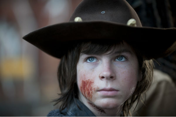 A bloody Carl Grimes &#40;Chandler Riggs&#41;, who just survived a horrifying attack, appears in a scene from AMC&#39;s &#39;The Walking Dead&#39; season 4 finale, which aired on March 30, 2014. <span class=meta>(Gene Page &#47; AMC)</span>