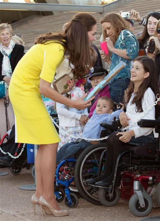 Kate Middleton, aka Catherine, Duchess of Cambridge, greets fans in wheelchairs after landing in Sydney, Australia, as part of their Royal Tour.