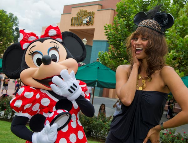 "<div class=""meta image-caption""><div class=""origin-logo origin-image ""><span></span></div><span class=""caption-text"">Supermodel and 'America's Next Top Model' host Tyra Banks sports a Disney couture mouse ear hat as she poses with Minnie Mouse at Disney's Hollywood Studios in Lake Buena Vista, Florida, on Aug. 30, 2011. (Gene Duncan / Walt Disney World)</span></div>"