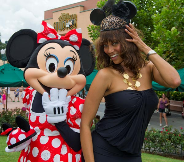 Supermodel and 'America's Next Top Model' host Tyra Banks sports a Disney couture mouse ear hat as she poses with Minnie Mouse at Disney's Hollywood Studios in Lake Buena Vista, Florida, on Aug. 30, 2011.