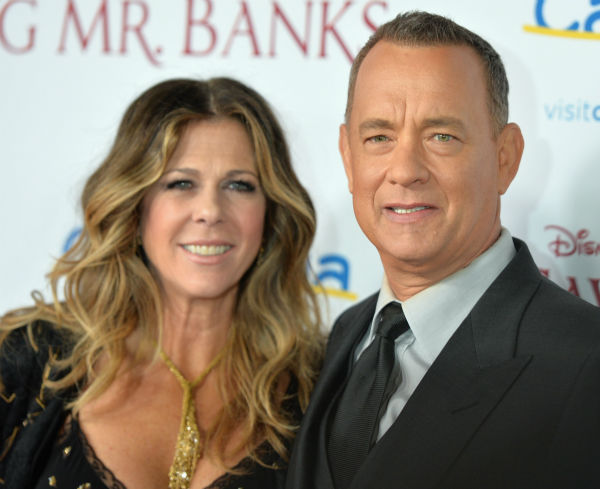 "<div class=""meta image-caption""><div class=""origin-logo origin-image ""><span></span></div><span class=""caption-text"">Tom Hanks, 57, and wife Rita Wilson, 57, attend the premiere of 'Saving Mr. Banks' at the Walt Disney Studios in Burbank, California on Dec. 9, 2013. In the film, Hanks plays Walt Disney, who convinced the author of 'Mary Poppins' to allow her story to be made into a film -- one that would become one of the world's favorites. (Alberto E. Rodriguez / WireImage for Walt Disney Studios)</span></div>"