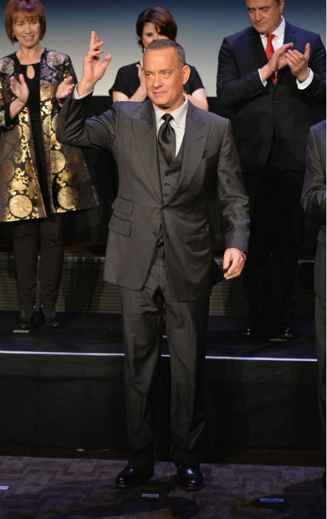 Tom Hanks, 57, appears at the premiere of &#39;Saving Mr. Banks&#39; on Dec. 9, 2013. In the film, he plays Walt Disney, who convinced P.L. Travers, the author of &#39;Mary Poppins,&#39; to allow her story to be made into a film -- one that would become one of the world&#39;s favorites. <span class=meta>(Alberto E. Rodriguez &#47; WireImage for Walt Disney Studios)</span>