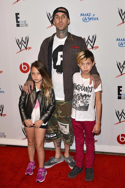 Blink-182 drummer Travis Barker and his children, Landon Asher Barker and Alabama Luella Barker, attend the Superstars for Hope event honoring the Make-A-Wish Foundation, held at The Pool at the Beverly Hills Hotel in Beverly Hills California on Aug. 15, 2013. <span class=meta>(Tony DiMaio &#47; startraksphoto.com)</span>
