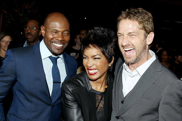 Director Antoine Fuqua, Angela Bassett and Gerard Butler share a laugh at an after party following a screening of &#39;Olympus Has Fallen&#39; in New York on March 11, 2013. <span class=meta>(Marion Curtis &#47; Startraksphoto.com)</span>