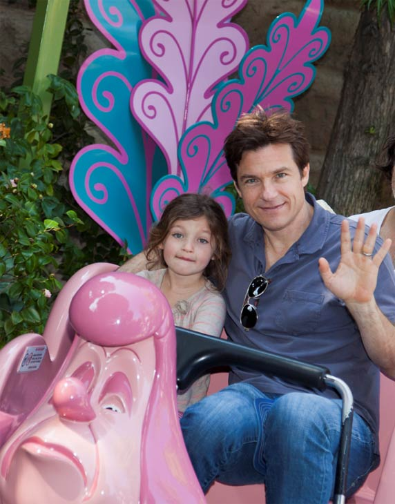 Jason Bateman and daughter Francesca, 5, ride the Alice in Wonderland attraction at Disneyland park in Anaheim, California on Wednesday, March 14, 2012.