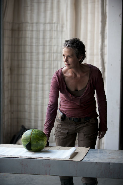 "<div class=""meta ""><span class=""caption-text "">Melissa McBride (Carol) channels her inner Gallagher on the set of AMC's 'The Walking Dead' while filming episode 3 of season 4, titled 'Isolation,' which aired on Oct. 27, 2013.  (Gene Page / AMC)</span></div>"
