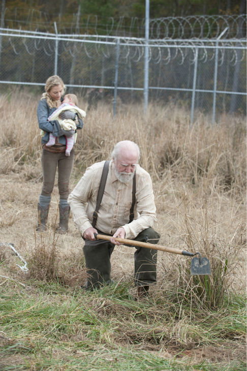 Beth Greene &#40;Emily Kinney&#41; takes care of baby Judith, Rick Grimes&#39; daughter, while Scott Wilson &#40;Hershel Greene&#41; farms, in this scene near the prison from AMC&#39;s &#39;The Walking Dead&#39; season 4 finale, which aired on March 30, 2014. <span class=meta>(Gene Page &#47; AMC)</span>