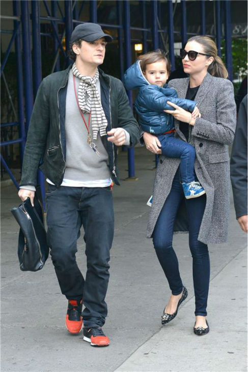 Orlando Bloom appears with wife Miranda Kerr and their son Flynn, 2, in New York City on Oct. 26, 2013.