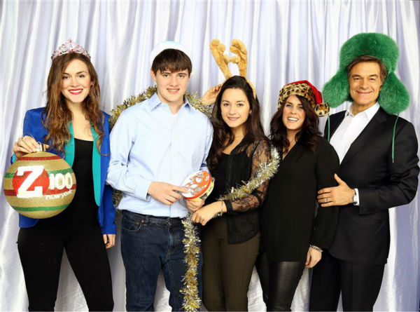 Talk show host Dr. Oz, wife Lisa and their daughters pose in a holiday-themed photo booth at Z100&#39;s Jingle Ball 2013 on Dec. 13, 2013, just before Christmas. <span class=meta>(Sara Jaye Weiss  &#47; Startraksphoto.com)</span>