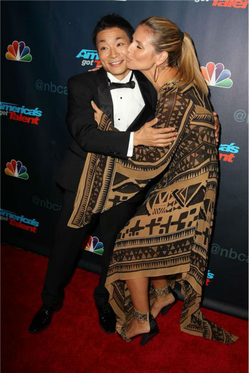 &#39;America&#39;s Got Talent&#39; co-judge Heidi Klum kisses season 8 winner and dancer Kenichi Ebina on the red carpet after the finale at Radio City Music Hall in New York on Sept. 18, 2013. <span class=meta>(Amanda Schwab &#47; Startraksphoto.com)</span>