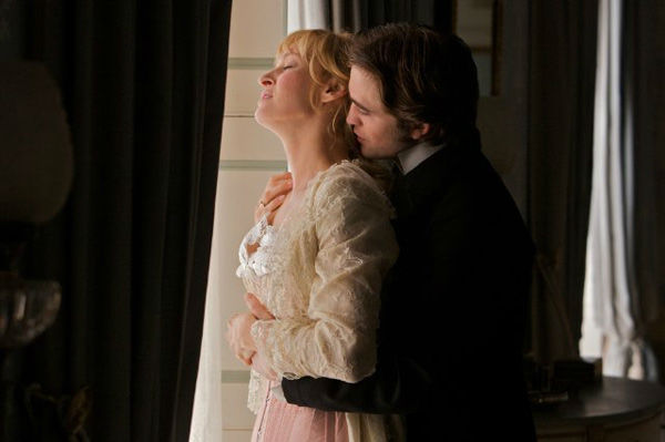 Robert Pattinson and Uma Thurman appear in a still from the 2012 movie 'Bel Ami.'