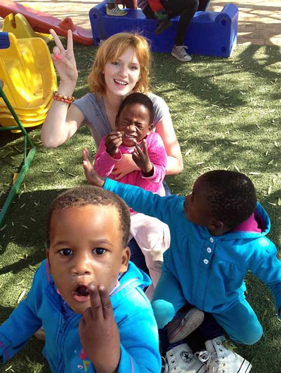 Bella Thorne plays with children at the Sparrow Village Orphanage, which houses kids suffering from HIV and AIDS, in Roodepoort, South Africa on June 24, 2013.
