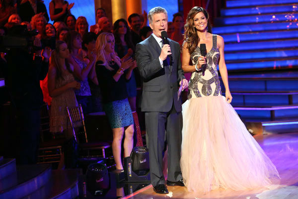Hosts Tom Bergeron and Brooke Burke Charvet...