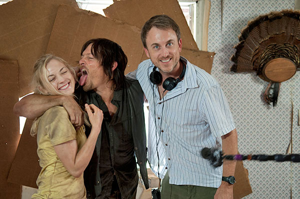 "<div class=""meta ""><span class=""caption-text "">Norman Reedus (Daryl Dixon) demonstrates one of his signature photo poses on Emily Kinney (Beth Greene) near a crew member on the set of AMC's 'The Walking Dead' episode 12, 'Still,' which aired on March 2, 2014. (Gene Page / AMC)</span></div>"