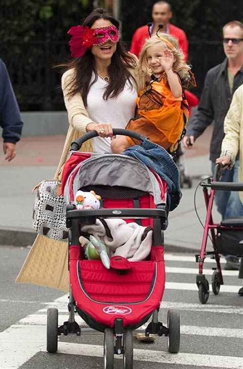 Talk show host and &#39;Real Housewives of New York&#39; alum Bethenny Frankel and daughter Bryn Hoppy are seen leaving a Duane Reade pharmacy in New York after buying what appear to be Halloween costumes and masks on Oct. 16, 2013. <span class=meta>(Freddie Baez &#47; Startraksphoto.com)</span>