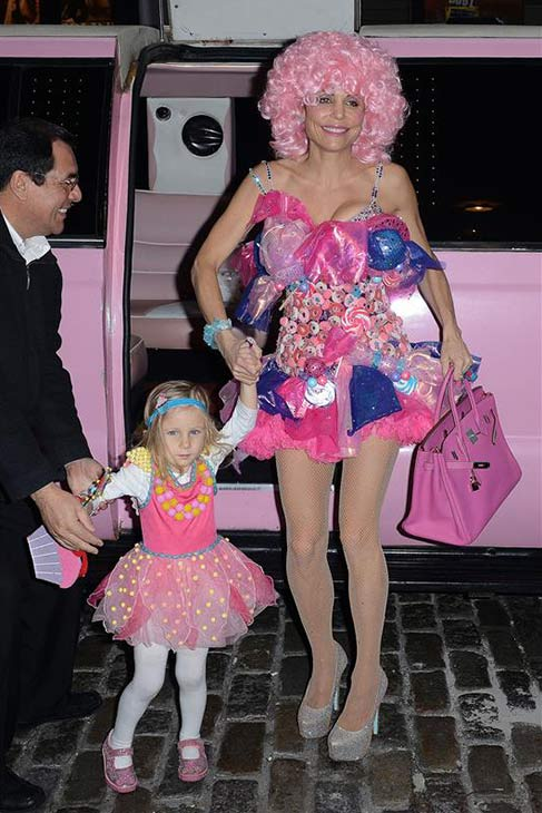 Talk show host Bethenny Frankel of &#39;Real Housewives&#39; fame and her daughter Byn exit a pink limo and arrive at a Halloween party in New York on Oct. 30, 2013. <span class=meta>(Humberto Carreno &#47; Startraksphoto.com)</span>