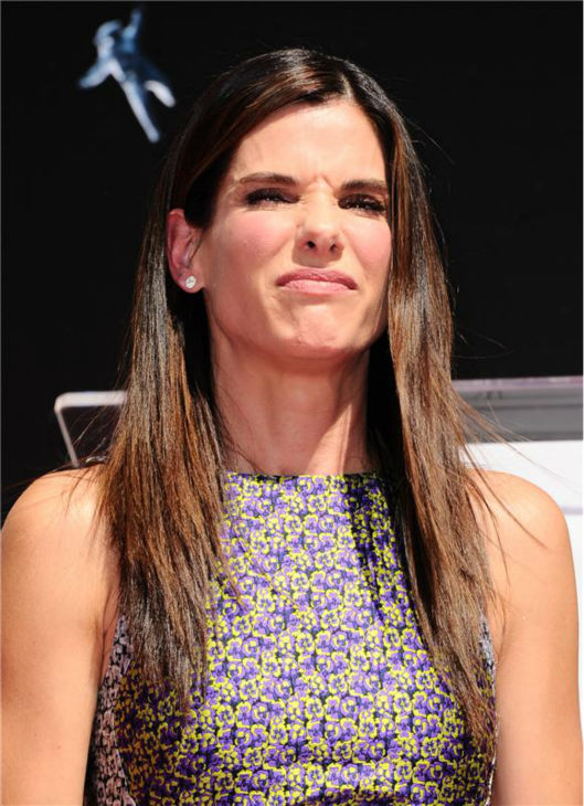 "<div class=""meta image-caption""><div class=""origin-logo origin-image ""><span></span></div><span class=""caption-text"">Sandra Bullock leaves her footprints in cement at the TCL Chinese Theatre in Hollywood on Sept. 25, 2013. (Sara De Boer / Startraksphoto.com)</span></div>"