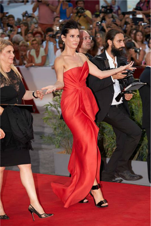 "<div class=""meta image-caption""><div class=""origin-logo origin-image ""><span></span></div><span class=""caption-text"">Sandra Bullock walks the red carpet -- as only Sandra Bullock can -- at the premiere of the film 'Gravity' at the 70th annual Venice International Film Festival on Aug. 28, 2013. She is wearing a red, silk, strapless J. Mendel Resort 2014 'Siren' gown. (Action Press / Startraksphoto.com)</span></div>"