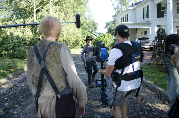 Chandler Riggs &#40;Carl Grimes&#41; and actors dressed as Walkers appear on the set of AMC&#39;s &#39;The Walking Dead&#39;s season 4 midseason premiere, titled &#39;After,&#39; which aired on Feb. 9, 2014. <span class=meta>(Gene Page &#47; AMC)</span>