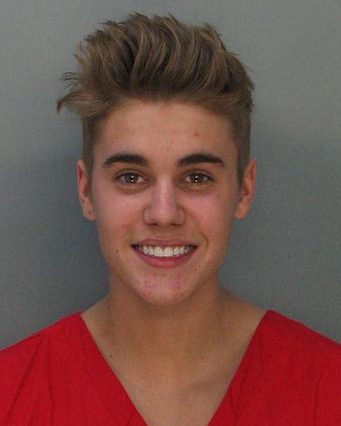 Justin Bieber is seen in a mug shot taken after he was arrested in Miami on Jan. 23, 2014 on suspicion of DUI and drag-racing. &#40;Check out more details about the arrest, including videos of him in court and being released, 7 things police revealed and answers to questions such as -- could Bieber be sent to jail or deported if convicted?.&#41; <span class=meta>(Miami Dade County Jail)</span>