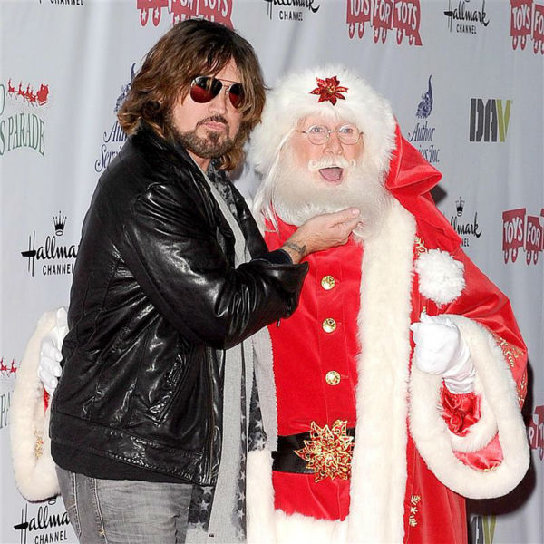 "<div class=""meta ""><span class=""caption-text "">Singer Billy Ray Cyrus, father of Miley Cyrus, appears with Santa Claus at the 2013 Hollywood Christmas Parade on Dec. 1, 2013. (Daniel Robertson / Startraksphoto.com)</span></div>"