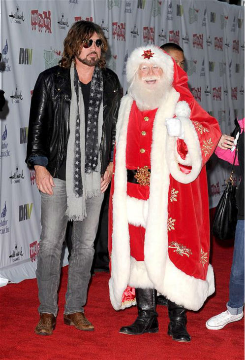 Singer Billy Ray Cyrus, father of Miley Cyrus, appears with Santa Claus at the 2013 Hollywood Christmas Parade on Dec. 1, 2013. <span class=meta>(Daniel Robertson &#47; Startraksphoto.com)</span>