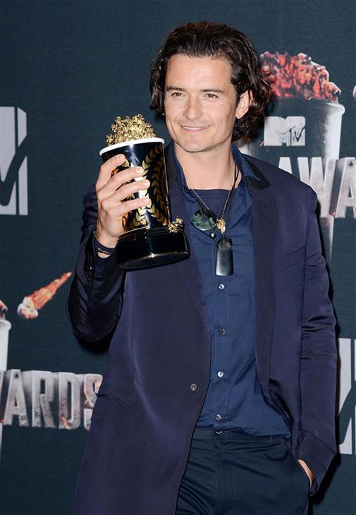 Orlando Bloom appears backstage at the 2014 MTV Movie Awards at the Nokia Theatre in Los Angeles on April 13, 2014. He and Evangeline Lilly won the award for Best Fight -- for their characters&#39; battle against the Orcs in the 2013 movie &#39;The Hobbit: The Desolation of Smaug.&#39; He reprises his &#39;Lord of the Rings&#39; role of Legolas in the prequel film, the second in a trilogy, while the former &#39;LOST&#39; actress plays fellow elf Tauriel. <span class=meta>(Lionel Hahn &#47; AbacaUSA &#47; Startraksphoto.com)</span>