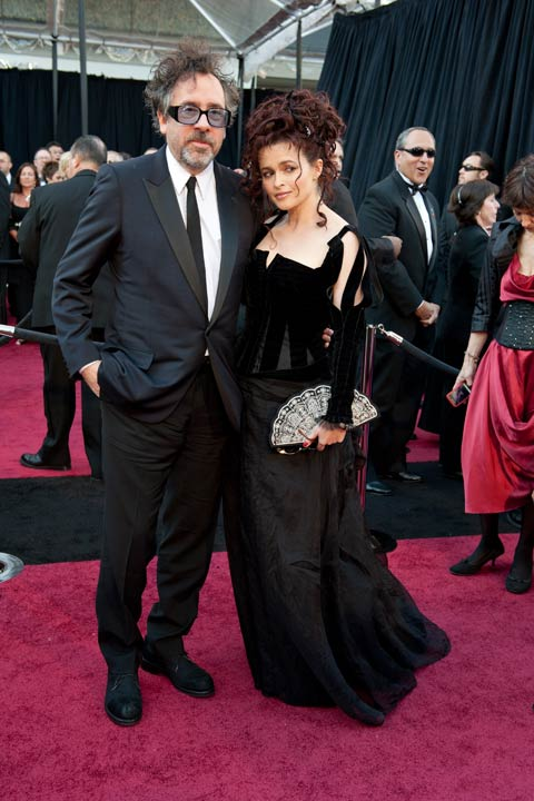 Helena Bonham Carter and Tim Burton arrive for the 83rd Annual Academy Awards at the Kodak Theatre in Hollywood, Calif. on Feb. 27, 2011. The actress donned a unique black dress designed by the &#39;Alice in Wonderland&#39; costume designer Colleen Atwood. She completed her look with a messy up-do and a Union Jack garter. The 2013 Oscar ceremony is scheduled to air February 24 on ABC. <span class=meta>(Ivan Vejar &#47; A.M.P.A.S.)</span>