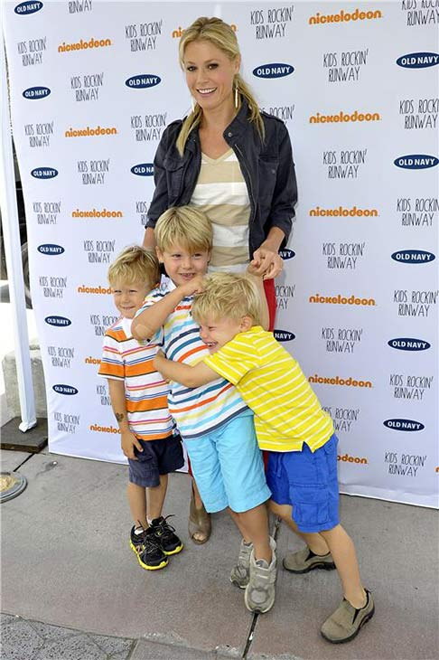 'Modern Family' star Julie Bowen, her eldest son Olivier and her twin sons John and Gustav attend the Old Navy Kids Rockin' Runway event in support of Baby2Baby at the Third Street Promenade in Santa Monica, California on Aug. 3, 2013.