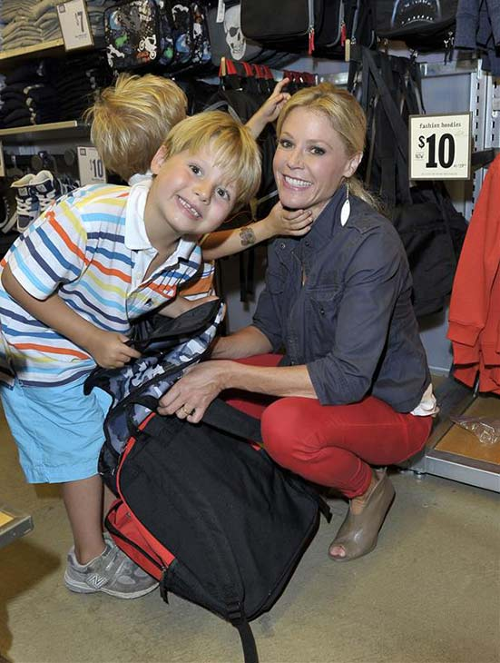'Modern Family' star Julie Bowen poses with two of her three sons at the Old Navy Kids Rockin' Runway event in support of Baby2Baby at the Third Street Promenade in Santa Monica, California on Aug. 3, 2013.