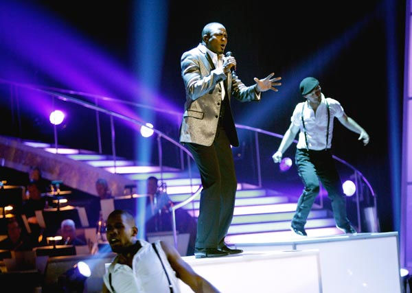 Wayne Brady sings and dances with The 'Macy's Stars of Dance' as part of a special tribute to James Brown in celebration of his birthday on ABC's 'Dancing With The Stars' in May 2011.