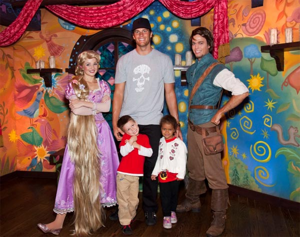 New England Patriots Quarterback Tom Brady, his son Jack (4) and niece Jordan (5), meet Rapunzel and Flynn Rider of Disney's animated film, 'Tangled,' while celebrating Jordan's fifth birthday at Disneyland in Anaheim, Calif., on Thursday, April 21, 2011.