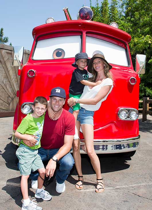 Tom Brady, his son Jack, 5, wife Gisele Bundchen and their son Benjamin, 3, pose with Red the Fire Truck at Cars Land at Disney California Adventure park in Anaheim, California, on Tuesday.
