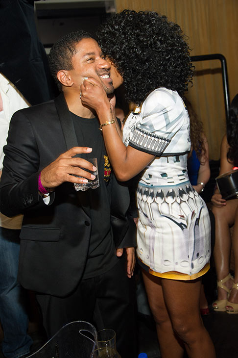 Brandy and fiance Ryan Press kiss at a New Year's Eve party she hosted at the LAVO nightclub in Las Vegas on Dec. 31, 2012.