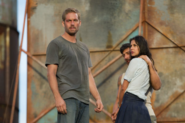 Paul Walker, David Belle and Catalina Denis appear in a scene from the 2014 action movie &#39;Brick Mansions.&#39; Walker plays an undercover cop. The film is set in Detroit in 2018. Brick Mansions is a government-quarantined housing project that is home to criminals. Belle plays one of its residents, ex-con Lino. Denis plays his ex-girlfriend, who gets kidnapped by the drug kingpin Tremaine. <span class=meta>(Philippe Bosse &#47; Relativity Media &#47; EuropaCorp &#47;Transfilm International Inc.)</span>