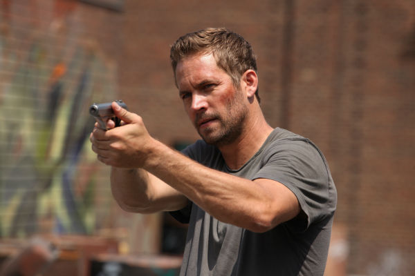 "<div class=""meta ""><span class=""caption-text "">Paul Walker appears in a scene from the 2014 action movie 'Brick Mansions.' He plays an undercover cop. The film is set in Detroit in 2018. Brick Mansions is a government-quarantined housing project that is home to criminals. (Philippe Bosse / Relativity Media / EuropaCorp /Transfilm International Inc.)</span></div>"