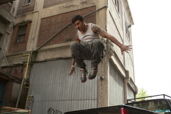 "<div class=""meta ""><span class=""caption-text "">David Belle appears in a scene from the 2014 action movie 'Brick Mansions.' The film is set in Detroit in 2018. Brick Mansions is a government-quarantined housing project that is home to criminals. Belle plays one of its residents, Lino. The actor also starred in the French film 'District B13,' on which 'Brick Mansions' is based. (Philippe Bosse / Relativity Media / EuropaCorp /Transfilm International Inc.)</span></div>"
