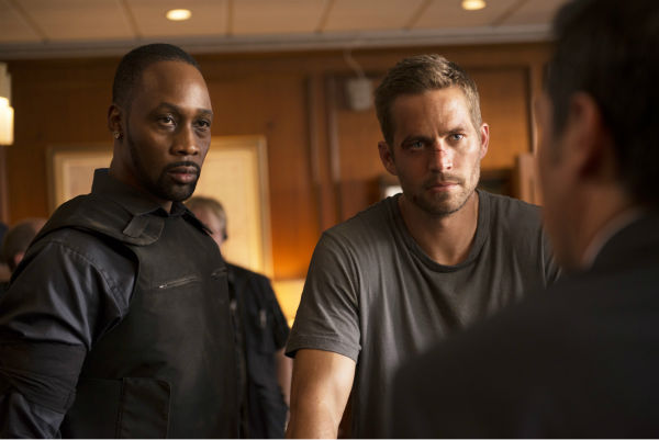 RZA and Paul Walker appear in a scene from the 2014 action movie &#39;Brick Mansions.&#39; RZA plays a villain, the drug kingpin Tremaine, who is in possession of a weapon of mass destruction. Walker plays an undercover cop. The film is set in Detroit in 2018. Brick Mansions is a government-quarantined housing project that is home to criminals. <span class=meta>(Philippe Bosse &#47; Relativity Media &#47; EuropaCorp &#47;Transfilm International Inc.)</span>