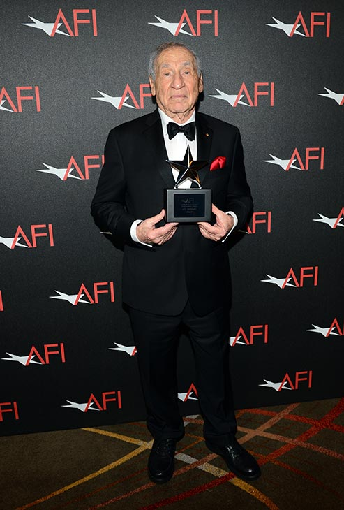"<div class=""meta image-caption""><div class=""origin-logo origin-image ""><span></span></div><span class=""caption-text"">Honoree Mel Brooks holds his American Film Institute Lifetime Achievement Award at a gala at the Dolby Theatre in Los Angeles on Thursday, June 6, 2013. (Kevin Mazur / American Film Institute)</span></div>"
