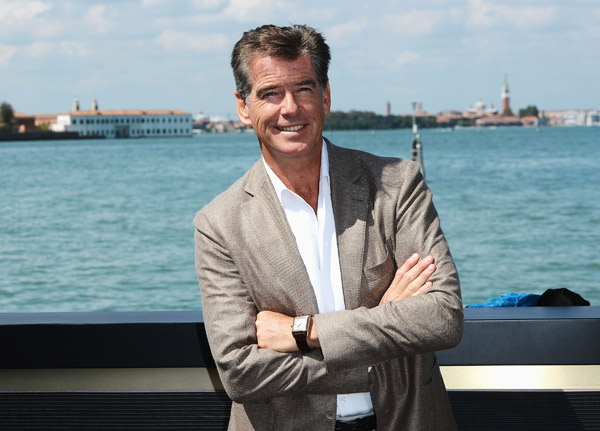 Pierce Brosnan, wearing a suit and a Squadra Rose Gold Jaeger-LeCoultre watch, appears at the Venice Movie Stars Lounge at the Venice Film Festival in Ita
