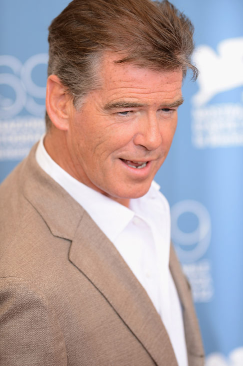 Pierce Brosnan (second from right), wearing a suit and a Squadra Rose Gold Jaeger-LeCoultre watch, attends the photo call for 'Love Is All You Need' at the Venice Film Festival in
