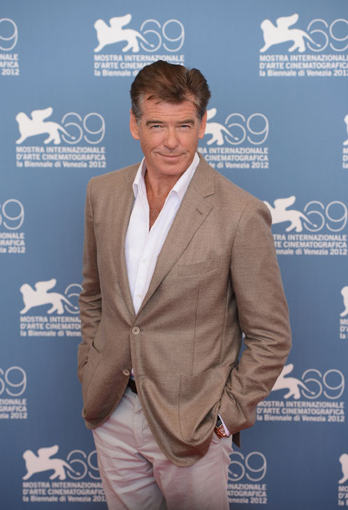 Pierce Brosnan (second from right), wearing a suit and a Squadra Rose Gold Jaeger-LeCoultre watch, attends the photo call for 'Love Is All You Need' at the Venice Film Festival
