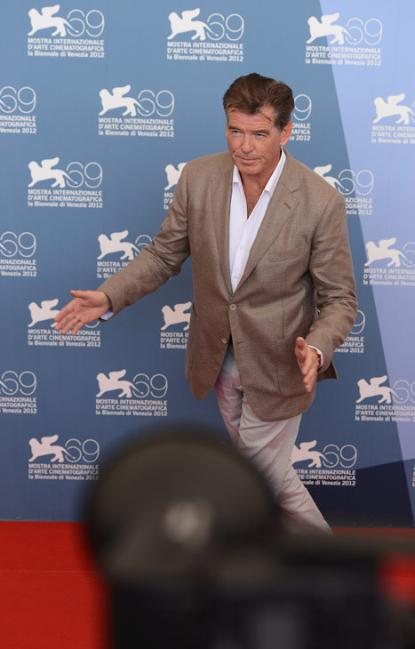 Pierce Brosnan (second from right), wearing a suit and a Squadra Rose Gold Jaeger-LeCoultre watch, attends the photo call for 'Love Is All You Need' at the Venice Film Festival in Italy on